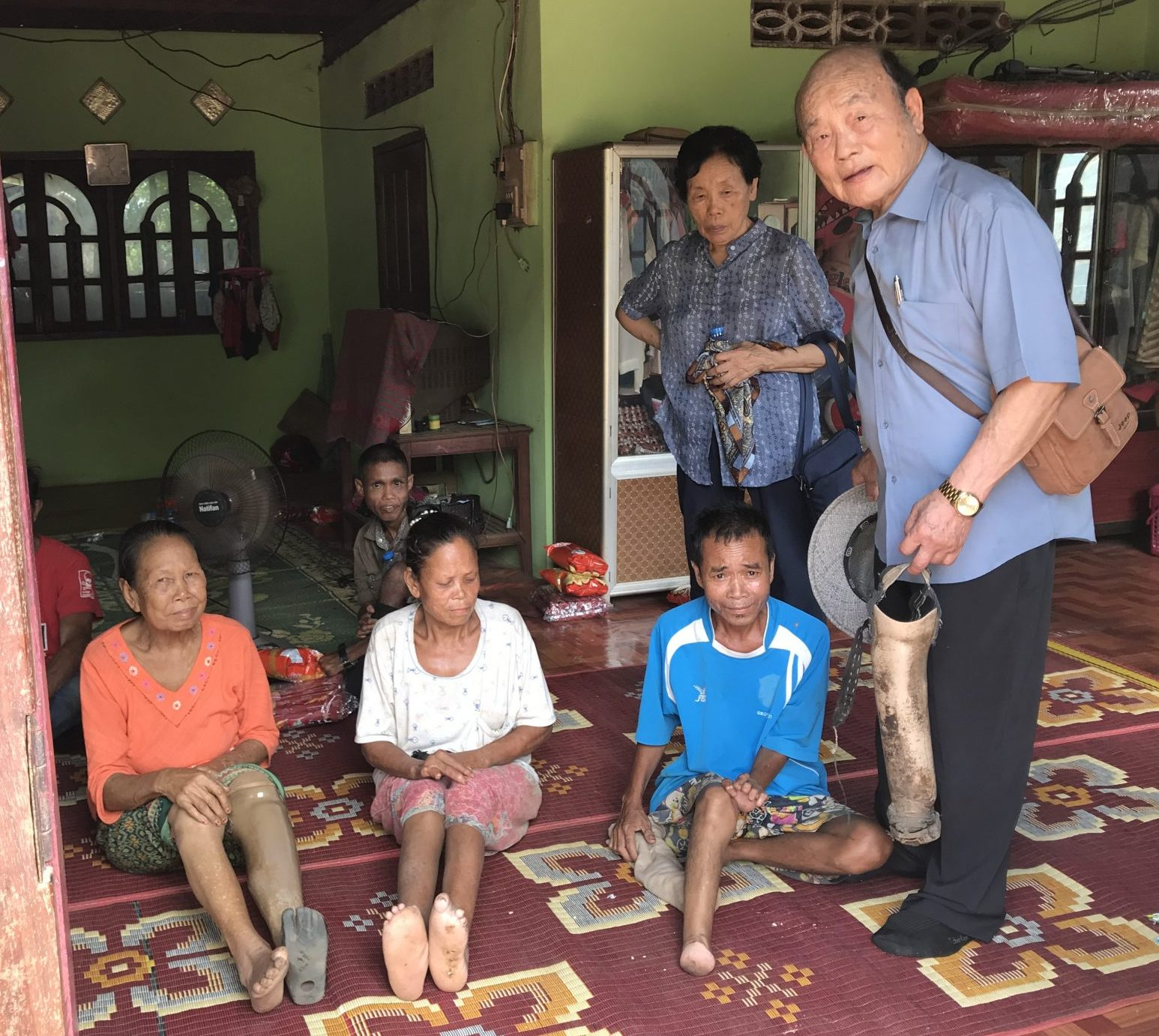 Missionary C. Y. Kim with Laos Lepers