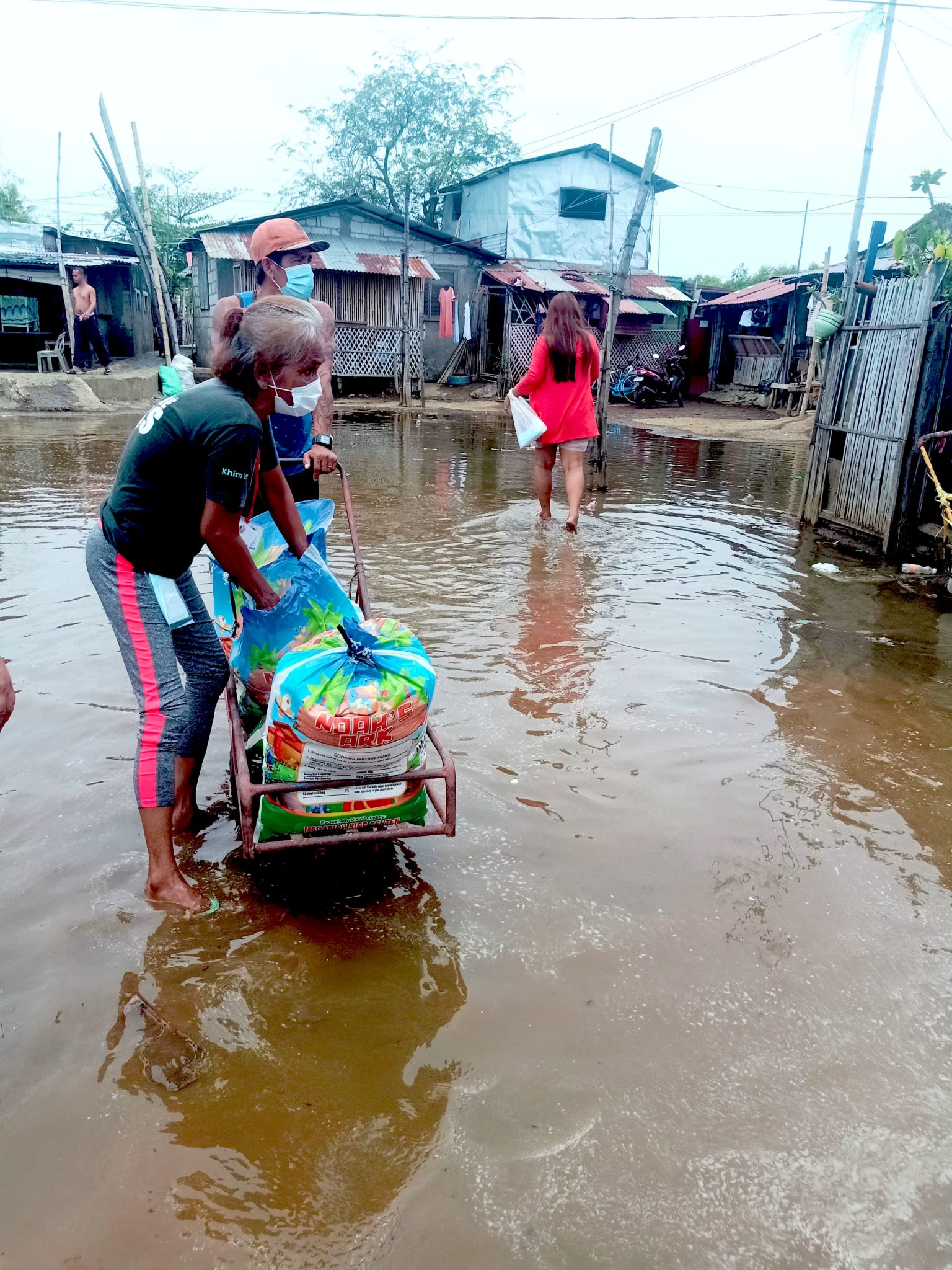 Distributing Food Through Flood Water in the Community